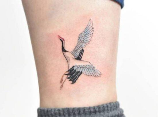 Trana-tatuering: Betydelse, design, historia och foton