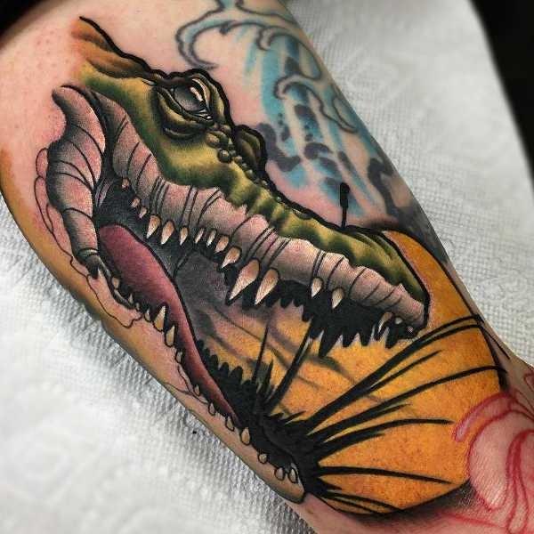 Krokodil tatuering: Betydelse, design, historia och foton