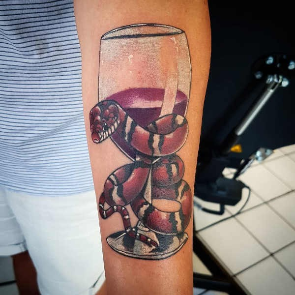 Orm tatuering: Betydelse, design, historia och foton