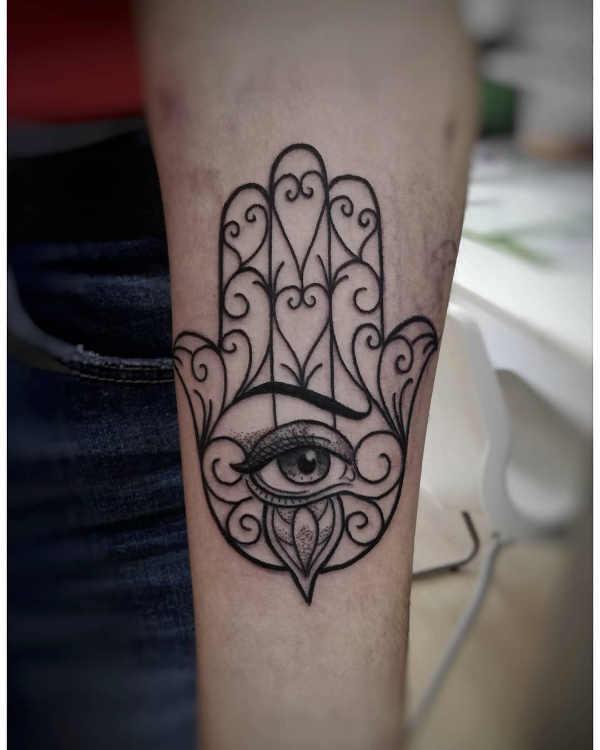 Hamsa tatuering: Betydelse, design, historia och foton Tatuering idéer och betydelser