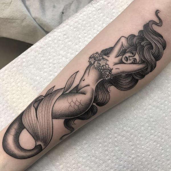 Sjöjungfru tatuering: Betydelse, design, historia och foton Tatuering idéer och betydelser